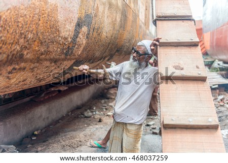DHAKA, BANGLADESH - August 13: Local workers are working to repair ships in dockyard on August, 13, 2016 in Dhaka, Bangladesh