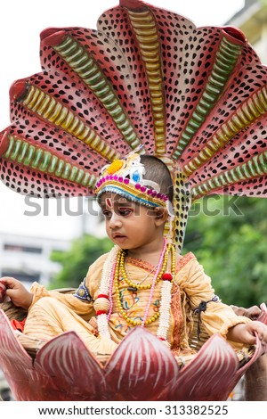 Dhaka, Bangladesh - September 04, 2015: A child dressed as Lord Krishna on the occasion of Janmashtami in Dhakeshwari Mandir, Dhaka, Bangladesh