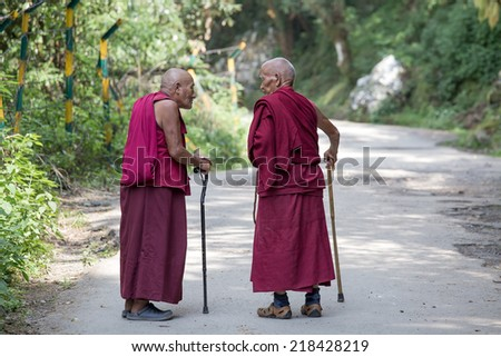 DHARAMSALA, INDIA - SEPTEMBER 20 2014: Two old unidentified Tibetan Buddhist monk in the Dharamsala near Dalai Lama's residence. - stock photo