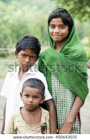 DHARNI, MAHARASHTRA, INDIA - JULY 9: Unidentified Happy Indian rural school children at their Village, Dharni, Maharashtra, India 9 July 2015.