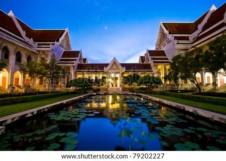 Dhevalai, Thai Temple in dusk,Thailand - stock photo