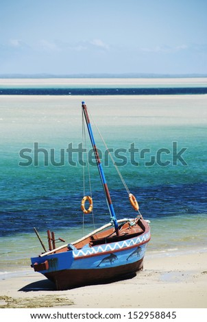 Dhow at the water's edge, Mozambique. Portrait - stock photo