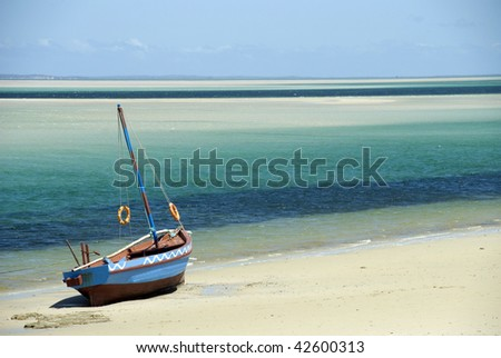 Dhow at the waters edge - landscape - stock photo