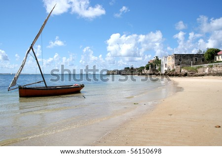 Dhow Boat on the surreal coastline of the old city of Ilha Mocambique (Mozambique Island). Taken at Mozambique Island, Mozambique. - stock photo