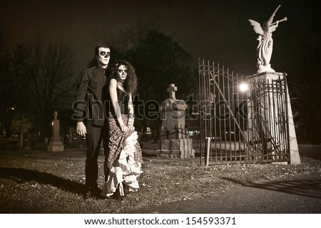 Dia de los Muerto Costume - Day of the dead is a mexican holiday. Here is a beautiful dead couple in a cemetery ! - stock photo