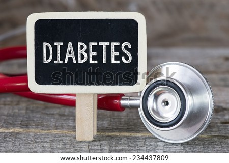 Diabetes and stethoscope. Medecine concept. Blackboard with word diabetes and stethoscope - stock photo