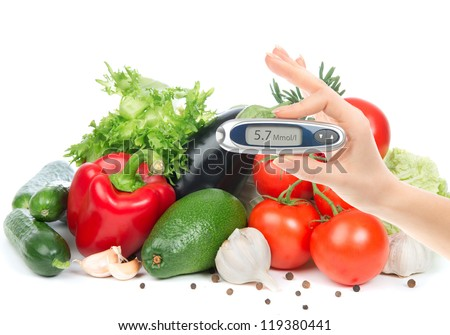Diabetes concept glucometer for glucose level blood test in hand and healthy organic food on a white background - stock photo