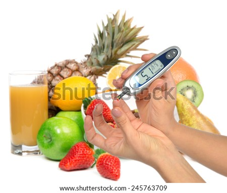 Diabetes diabetic concept. Measuring glucose level blood test on organic food fruits and vegetables background - stock photo