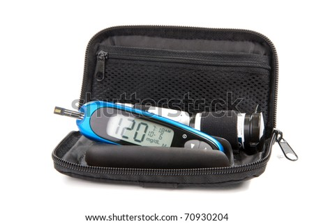 Diabetes glucose level blood test using ultra mini glucometer kit and small drop of blood from finger and test strips isolated on a white background. Device shows 120  mg/dL which is normal - stock photo