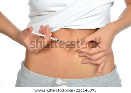 Diabetes patient insulin shot by syringe with dose of lantus, subcutaneous abdomen vaccination isolated on a white background - stock photo