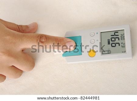 Diabetes patient measuring glucose level blood test - stock photo