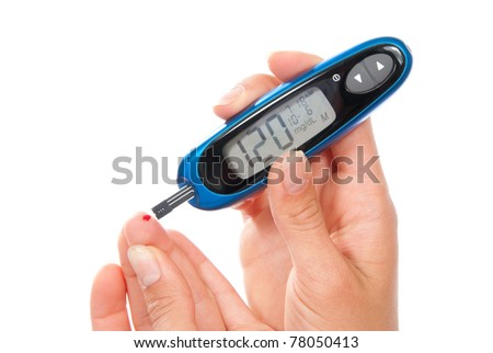 Diabetes patient measuring glucose level blood test using ultra mini glucometer and small drop of blood from finger and test strips. Device show 120 - stock photo