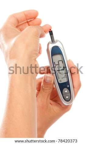 Diabetes patient measuring glucose sugar level blood test using ultra mini glucometer and small drop of blood from finger and test strips isolated on a white background - stock photo