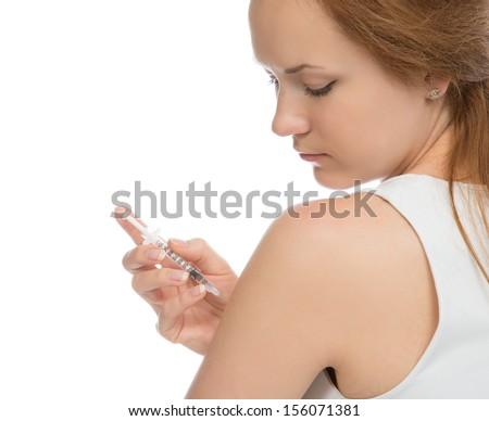 Diabetes woman patient make an arm subcutaneous insulin syringe injection vaccination shot at home on white - stock photo