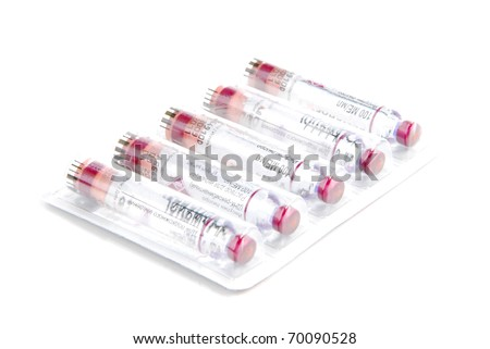 Diabetic humalog insulin vials. Five new Cartridges for syringe-pen in a medicine box for diabetic patient on white background. Fast acting insulin analogue - stock photo