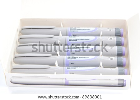 Diabetic insulin syringe injectors. Five new syringe-pen in a medicine box for diabetic patient on white background - stock photo