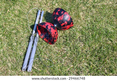 Diabolo toy on the grass with plenty of copy space