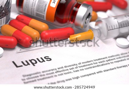 Diagnosis - Lupus. Medical Concept with Red Pills, Injections and Syringe. Selective Focus. 3D Render. - stock photo