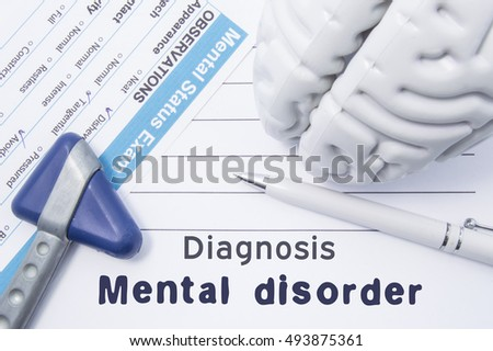 Diagnosis Mental Disorder. Medical psychiatrist opinion with written psychiatric diagnosis of Mental Disorder, questionnaire mental status exam, shape brain and neurological hammer is on table