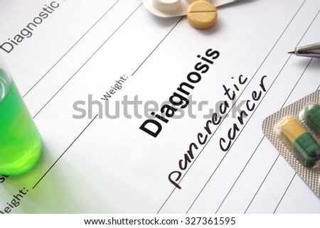 Diagnosis pancreatic cancer  written in the diagnostic form and pills. - stock photo