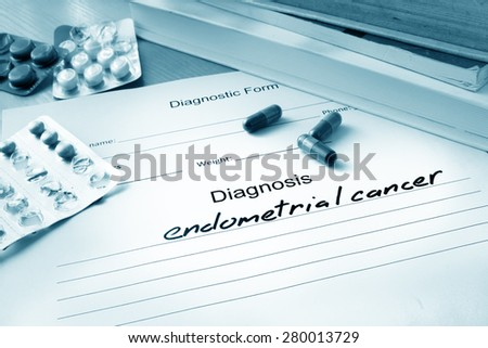 Diagnostic form with diagnosis endometrial cancer and pills. - stock photo
