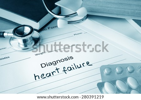Diagnostic form with diagnosis heart failure and pills. - stock photo