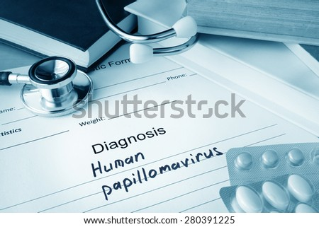 Diagnostic form with diagnosis Human papillomavirus HPV and pills. - stock photo