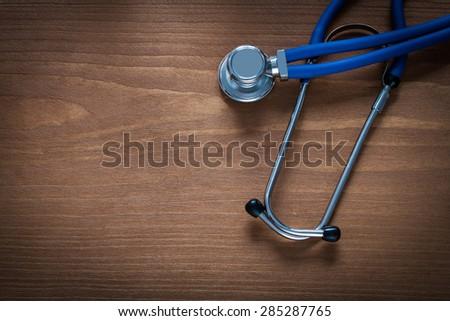 Diagnostic tool for medical exploration on pine vintage wooden board medicine concept  - stock photo