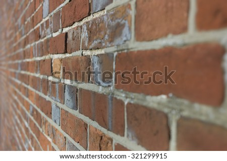 Diagonal background of brown and red brick wall with blur - stock photo