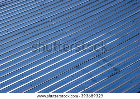 Diagonal blue metal lines texture.