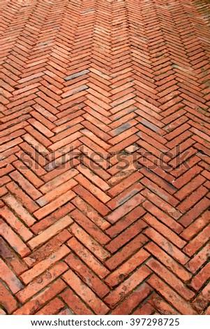 Diagonal brick path in Tuscany - stock photo