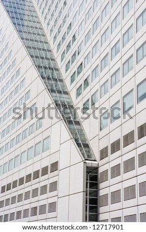 Diagonal cut in modern building with white tiles