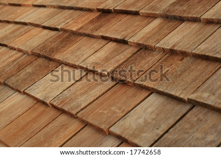 Diagonal detail of brown wood roof shingles - stock photo