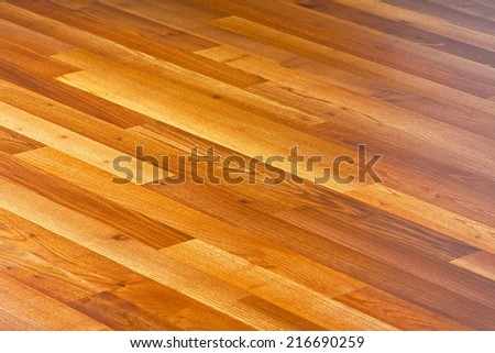 Diagonal lines of laminated hardwood parquet floor  - stock photo