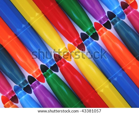 Diagonal row of colored felt pens for different uses - stock photo