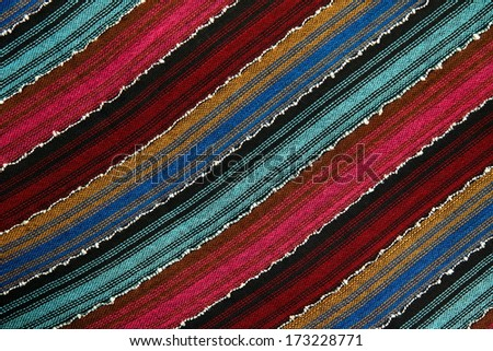 diagonal striped fabric background texture from vibrant colors - stock photo