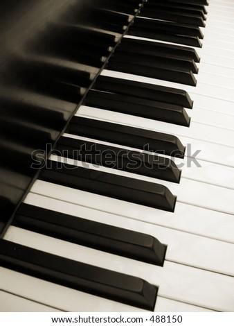 diagonal view of piano keys in sepia - stock photo