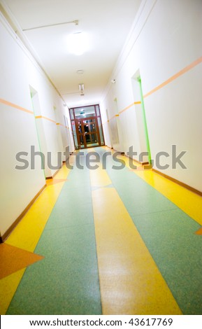 Diagonal view of the corridor with door at the end - stock photo