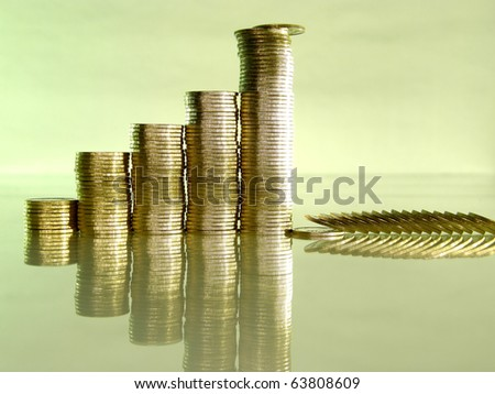 diagram consisting of piles of coins, denotes financial collapse - stock photo