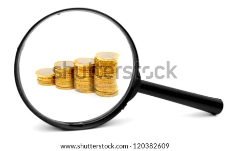 Diagram from coins and a magnifier. On the white. - stock photo
