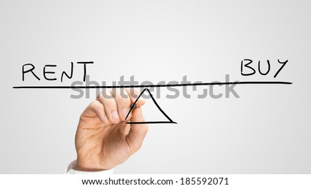 Diagram of a seesaw showing buy and rent in perfect equilibrium. - stock photo