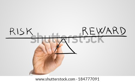 Diagram of a seesaw showing risk and reward in perfect equilibrium showing that the cost of paying for the benefits is equal to the advantages - stock photo