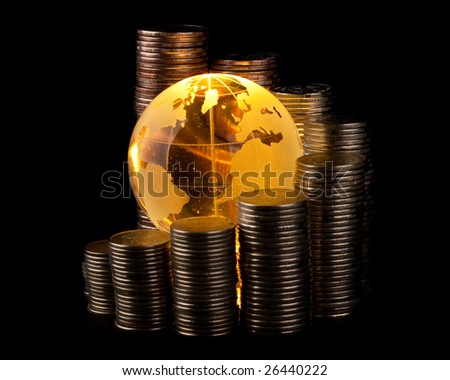 Diagram of growth from coins and yellow glass globe. Global business concept.