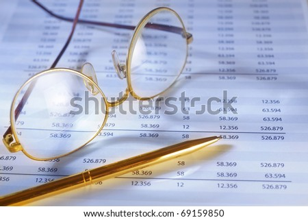 diagram on financial report with pen. Business background - stock photo