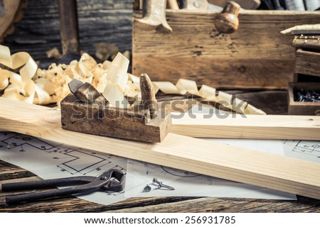 Diagrams and drafting tools in carpentry workshop - stock photo
