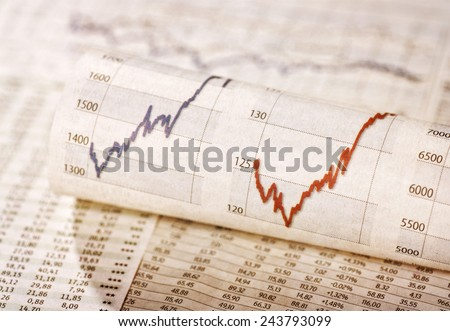 Diagrams with rising share prices and exchange rate tables - stock photo