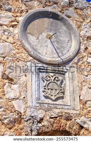 Dial of a solar clock on medieval building wall, Dalmatian coast, Croatia - stock photo