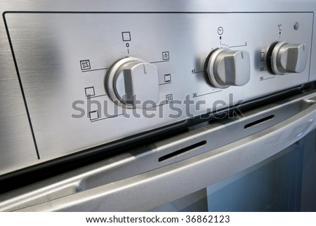 dial of a stainless steel electric oven - stock photo