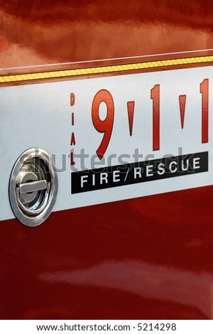 Dial 911 sign on fire engine truck - stock photo