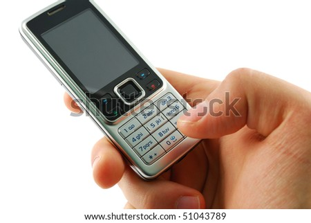 Dialing a mobile phone on a white background. - stock photo